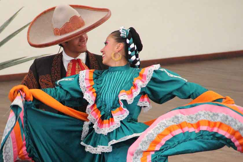 Man and woman mariachi dancing