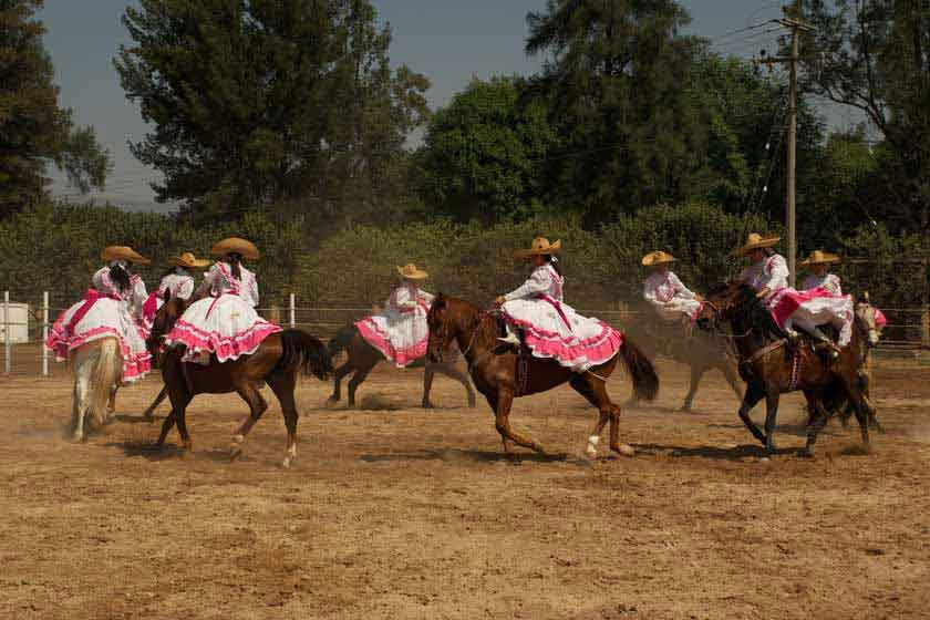 Women charreria's on horses