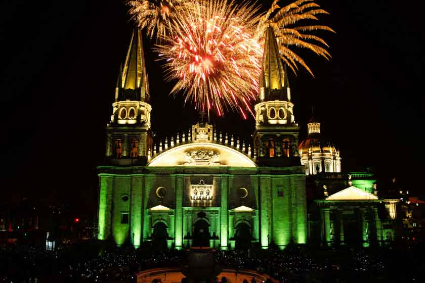 The Guadalajara Cathedral lit up at night with fireworks