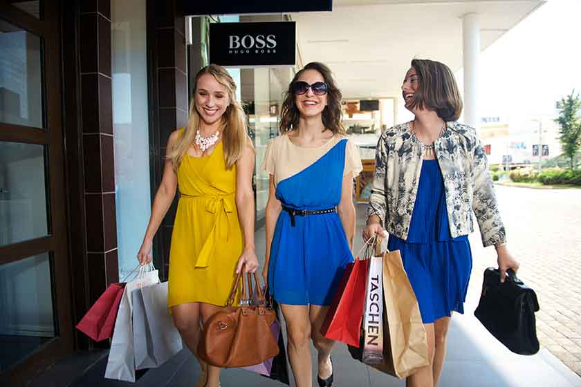 Three women shopping at Andares shopping center